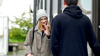 Hipster girl smoking cigarette and talking with her friend