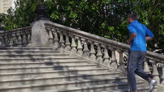 Jogger running up on stairs, slow motion shot at 240fps, steadycam shot