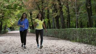 Joggers walking with liquids, slow motion shot, steadycam shot
