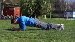 Man doing exercises in park, slow motion shot at 240fps, steadycam shot