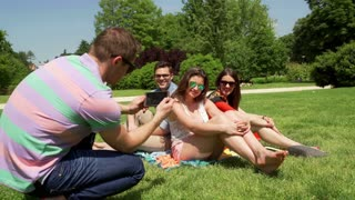 Man doing photo of his friends in the park, steadycam shot