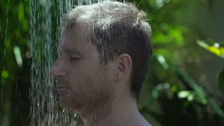 Man getting wet in the shower, slow motion shot