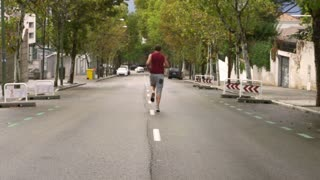 Man jogging alone on the road, slow motion shot at 240fps, steadycam shot