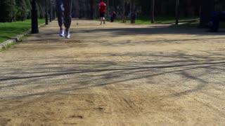 Man jogging in park, slow motion shot at 120fps, steadycam shot