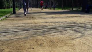 Man jogging in park, slow motion shot at 240fps, steadycam shot