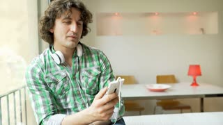 Man listening music on headphones and enjoying it, steadycam shot