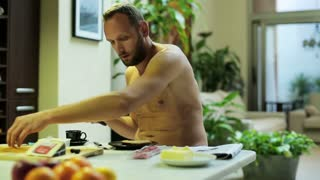 man preparing a sandwich