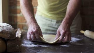 man preparing dough, slow motion at 240 fps