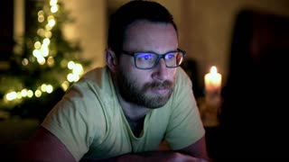 Man reading something on the internet and looking thoughtful
