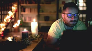 Man relaxing and watching something funny on laptop at home