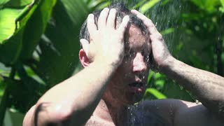 Man showering head in the garden, slow motion shot at 240fps