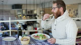 Man sitting in the restaurant and eating food