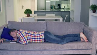 Man sleeping on the sofa at home