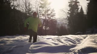 Man training on the deep snow, steadycam shot, slow motion shot at 240fps