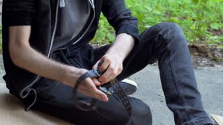 Man using needle with drugs because of his addicition, steadycam shot