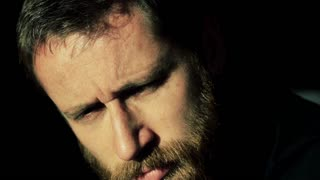 Man with ginger beard looking very pensive and thinking about something