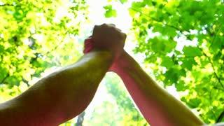Men hugging hands, steadycam shot, slow motion shot at 240fps