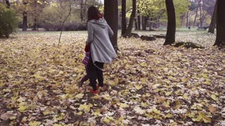 Mother and son having fun in the park, steadycam shot, slow motion shot
