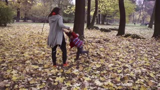 Mother and son having fun in the park, steadycam, slow motion shot at 240fps