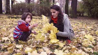 Mother and son playing in the park, steadycam shot, slow motion shot at 240fps
