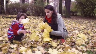 Mother and son playing in the park, steadycam shot, slow motion shot