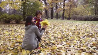 Mother with child standing in the park, steadycam, slow motion shot at 240fps