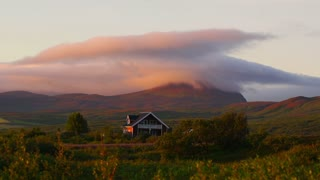 Mountain valley landscape of meadow and old cottage, house, timelapse