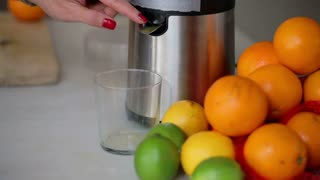 Orange juice pouring to glass, closeup, steadycam shot.