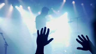 People applaud and recording rock concert in the club, steadycam shot