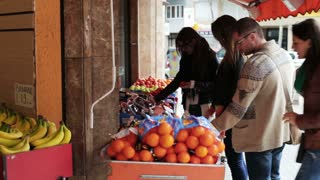 People buying fruits on the street, steadicam shot