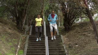 People jogging on stairs, slow motion shot at 240fps, steadycam shot