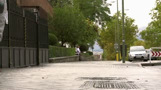 People jogging on the pavement, slow motion shot at 240fps, steadycam shot