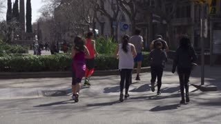 People jogging on the street, slow motion shot at 240fps, steadycam shot