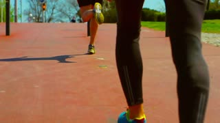 People running at sunny day in the city, steadycam shot, slow motion shot at 240