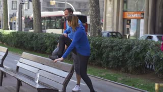 People stretching on street bench, slow motion shot at 240fps, steadycam shot