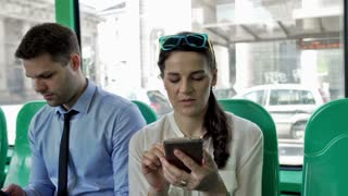 People traveling in the bus and using smartphones, steadycam shot