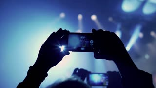 Person record rock concert on cellphone in the club, steadycam shot