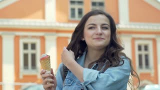 Pretty girl eating delicious ice creams and looking happy