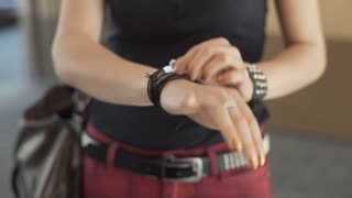 Punk girl touching her bracelet with studs and thong