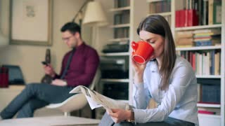Quiet businesscouple sitting at home and not talking