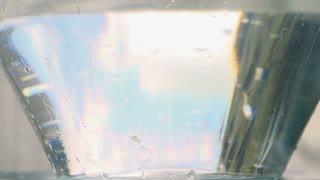 Radish falling into water, closeup, slow motion shot at 240fps