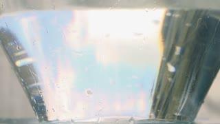 Radish falling into water, closeup, slow motion shot