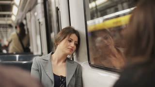 Sad woman sitting in the subway, steadycam shot
