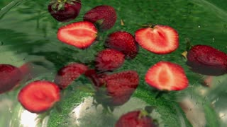 Strawberries spinning in the water, closeup, slow motion shot at 240fps