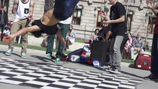 Street dance performance in the city, slow motion shot at 120fps, steadycam shot