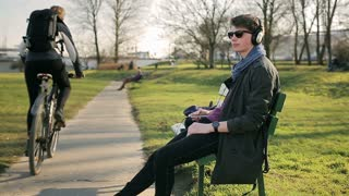 Student listening music and going from park