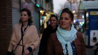 three women walking along the street