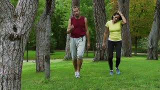 Tired joggers after run walking in the park, slow motion shot at 240fps