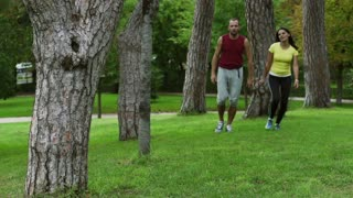 Tired people after run walking in the park, slow motion shot at 240fps