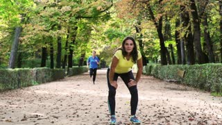 Tired woman after run looking to the camera, slow motion shot at 240fps, steady